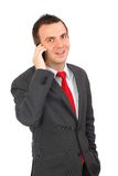 European businessman with cell phone. Isolated Stock Photography