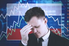 European businessman with declining finance graph. European businessman looks depressed with declining finance graph and Netherlands flag in the trade stock royalty free stock image