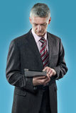 European businessman with digital tablet Royalty Free Stock Image