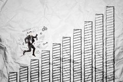 European businessman running above growth graph Royalty Free Stock Image