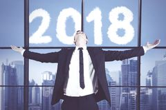 European businessman with numbers 2018 Stock Image