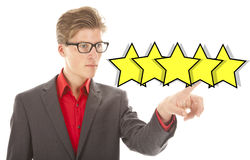 European businessman ranking with five yellow stars. On white background stock image