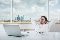 European businessman relaxing in office Stock Photography