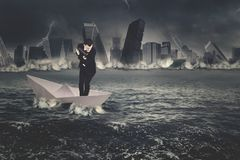 European businessman standing on the paper ship Royalty Free Stock Photography