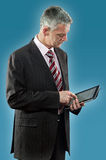 European businessman using digital tablet Stock Images