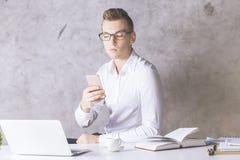 European businessman using smartphone Royalty Free Stock Photo