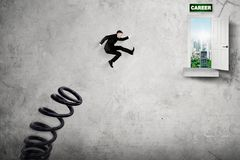 European businessman jumping toward career word Royalty Free Stock Photo