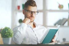 European businessman writing in organizer Royalty Free Stock Photo