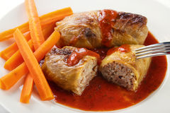 European cabbage rolls. On tomato sauce with steam cooked carrot Stock Photos
