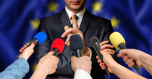 European candidate speaks to reporters - journalism concept Stock Images