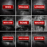 European capitals. Vintage electric red light display over a dark, grunge background. European capital cities stock images