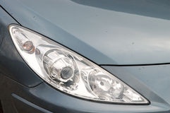 European car detail. Detail of a european car - headlight with few drops of rain Royalty Free Stock Images