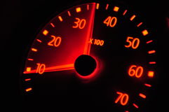 European car speedometer. Motion of an european car speedometer. Orange color Royalty Free Stock Photography