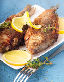 European carp with a thyme and lemon Stock Photos