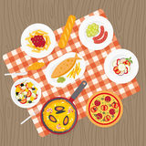 European catering service. Catering service. European food. Picnic blanket on table. Flat catering meal set. Different dishes on tablecloth. Europe cuisine top Stock Photography