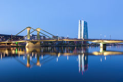 European Central Bank (ECB) in Frankfurt. FRANKFURT MAIN, GERMANY - APR 18: New European Central Bank (ECB) building and the Floesser bridge in Frankfurt. April Stock Photo