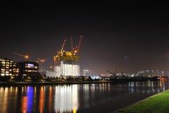 Skyscraper construction site by night Stock Photo