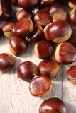 European chestnuts. On a wooden table Stock Image
