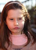 European child angry with a wool sweater Stock Photo