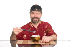 European in chinese attire eating rice Royalty Free Stock Images