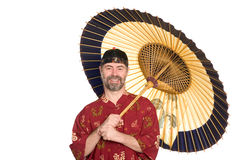 European in Chinese shirt and umbrella Royalty Free Stock Image