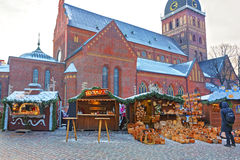 European Christmas fair stalls with straw baskets and other trad Stock Photography
