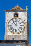 European church with tower and huge clock Royalty Free Stock Photos