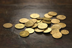 European circulation gold coins. Various European circulation gold coins from the 19th/20th century on rustic wooden background Stock Photography