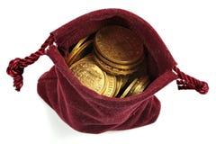 European circulation gold coins. Various European circulation gold coins from the 19th/20th century in a velvet purse isolated on white background Stock Photos