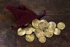 European circulation gold coins. Various European circulation gold coins from the 19th/20th century in a velvet purse on rustic wooden background Stock Photography