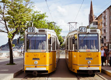 European cities, Budapest. Two yellow trams in Budapest, Hungary, may 2013 Stock Photo