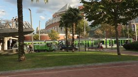 European city life, trams carry passengers, municipal services clean streets. Stock footage stock footage