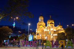 European city nocturne. Varna 2017 letters installation and bright illuminated Cathedral of the Assumption in Varna city at night.  Varna is Youth Capital of Royalty Free Stock Photos