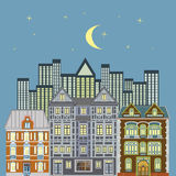 European Cityscape. Romantic view at a city skyline at evening showing three Victorian homes and skyscrapers in the back, with lots of details and loving Royalty Free Stock Images