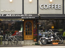 European coffee shop's facadewith motorbike and bicycle Royalty Free Stock Photo