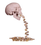European coins drops out of scary skull Royalty Free Stock Photography