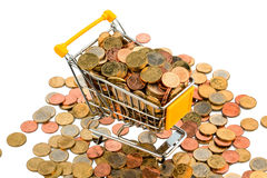 European coins. A shopping cart is full with euro coins, symbolic photo for purchasing power and consumption Royalty Free Stock Photography