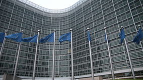European Commission with EU flags stock video footage