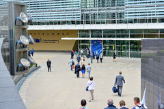 European Commission headquarter in Brussels. BRUSSELS, BELGIUM-SEPTEMBER 18, 2014: People entering modern building of the European Commission headquarter in Stock Photo
