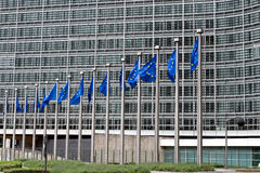 European Commission Headquarters. Waving European Union Flags in Front of European Commission Headquarters in Brussels, Belgium Royalty Free Stock Images