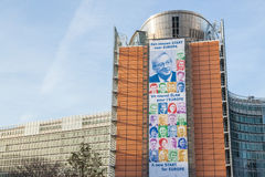 European Commission - new Juncker team. A poster on the Berlaymont building showing the new team of European Commissioners headed by  a former Prime Minister of Royalty Free Stock Photos
