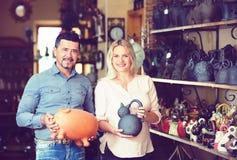 European couple buying crockery. European happy couple buying in workshop crockery royalty free stock images