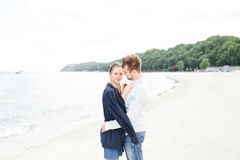 European couple relaxing on the sea Stock Image