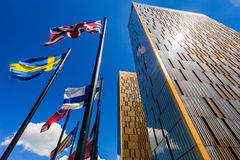 European Court of Justice in Luxembourg. The two towers of the European Court of Justice and flag poles in Luxembourg against blue sky with spectacular sun flare Stock Photos
