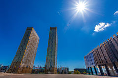 European Court of Justice in Luxembourg. The two towers of the European Court of Justice and flag poles in Luxembourg against blue sky with spectacular sun flare Royalty Free Stock Photos