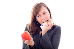 European crisis. Concept. Desperate woman with apple, eating Euro bank note, isolated on white background Royalty Free Stock Image