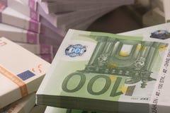 European Currency. A pile of papermoney on white background - gestapelte Geldscheine vor weissem Hintergrund stock photo