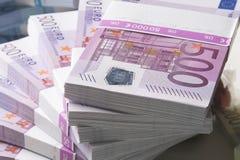 European Currency. A pile of papermoney on white background - gestapelte Geldscheine vor weissem Hintergrund stock image