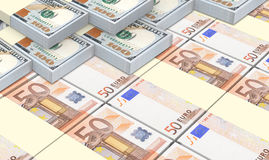 European currency bills stacks with american dollars background. Stock Images