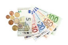 European currency coins and bills fanned out. All european currency coins and bills from 5 to 100 Euros - including new 5 euro bill - fanned out on white Stock Photography
